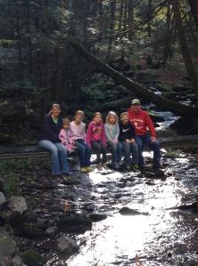 Brooks family on bridge over Brooks Run